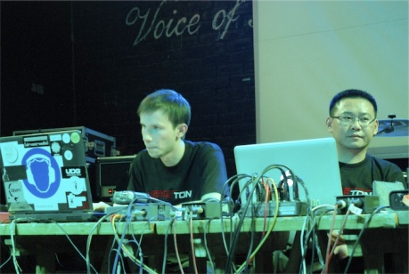 Er Dao & Piotr Michalowski on stage in Wuhan